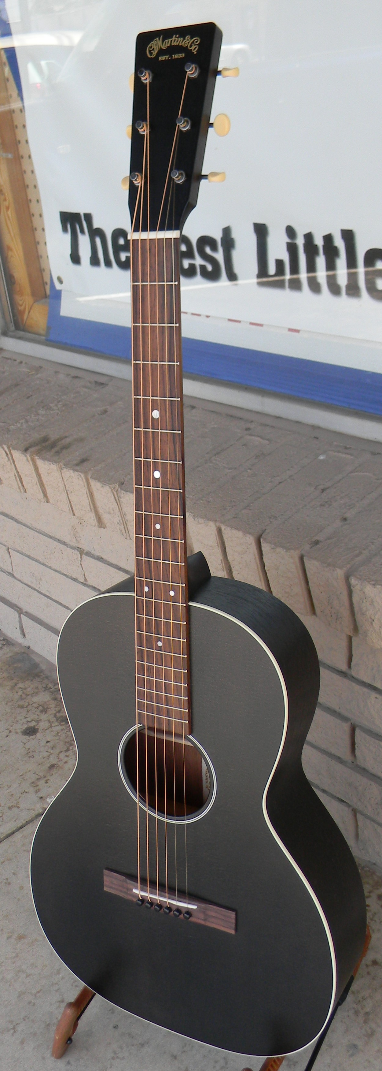 """Martin 00-17S Black Smoke. This one never fails to catch a person's eye. Auditorium sized 12 fret made of solid sitka spruce and mahogany with a translucent black finish that lets you see the wood grain. """"Open pore"""" treatment allows the woods to vibrate freely making for a robust and lively sounding guitar that is a joy to play. $1,859.00"""
