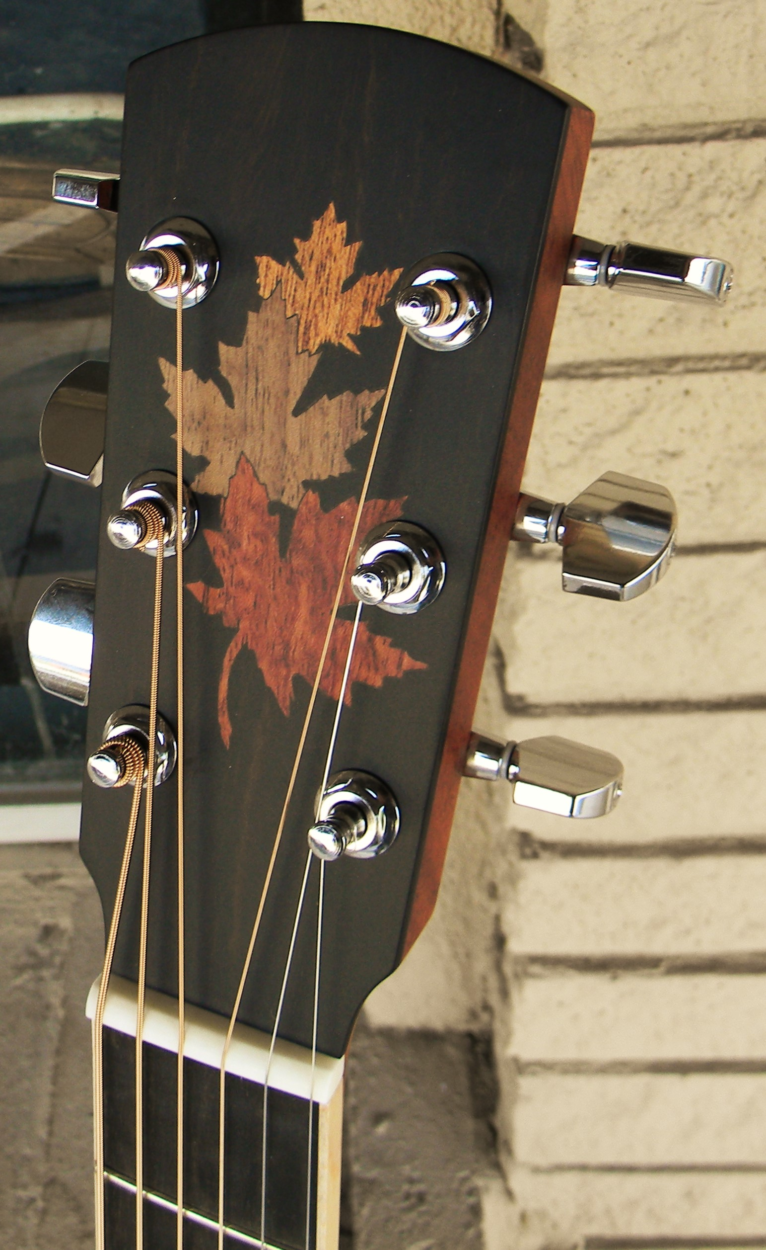 The Larrivee L03FM from their Custom Shop features stunning flamed maple back and sides, an abalone rosette, and lovely maple leaf inlays to pay homage to Larrivee's Canadian heritage, a;though today's Larrivee Guitars are made in Oxnard, California. This wonderful guitar defies the common perception of maple as being a sometimes overly bright sounding. It sounds rich and warm, plays like a dream and looks lovely. $1759.00