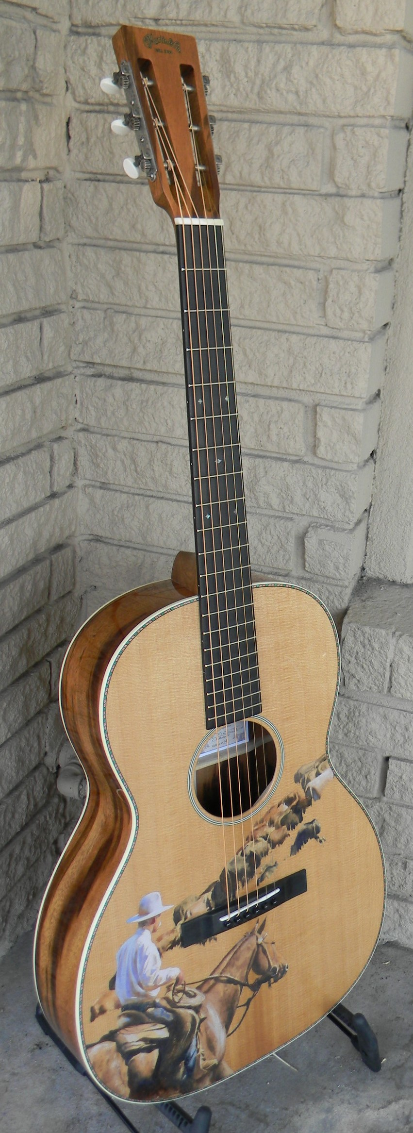 Martin Cowboy LE 2015. Made of torrefied VTS sitka spruce and Goncalo Alves. Instantly collectible # 14 of a small run for 2015. List : $3,999 Sale: $3,099