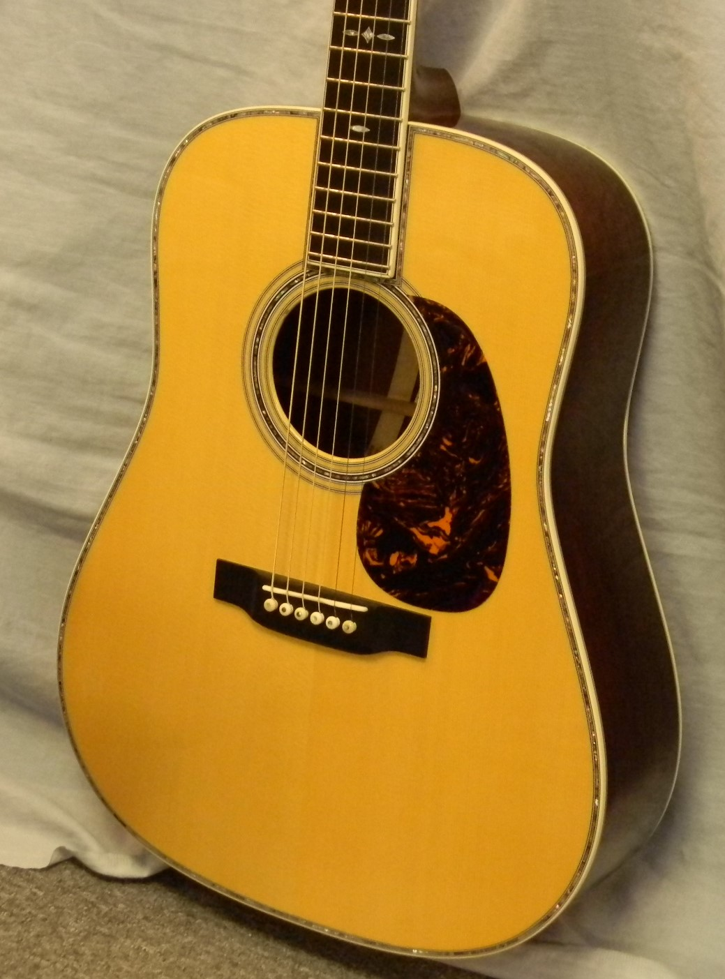 Martin SS D35 13. # 18 of 30 made in 2013. Near mint condition made of Adirondack spruce and Madagascar rosewood with cocobolo wave shaped center wedge. 42 style appointments and hide glue construction. List: $9,999.00 SALE: $6,500.00
