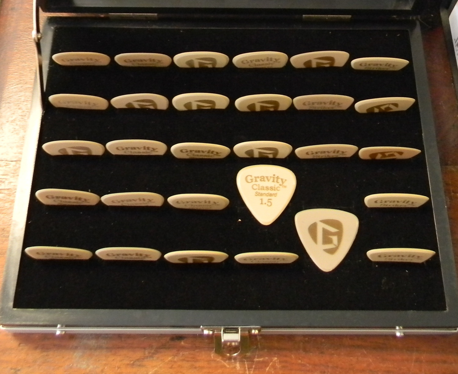 Gravity Gold Picks. The response to this $20 pick has been phenomenal. Not for everyone for sure, but many discriminating players have discovered added control, better tone, and more volume on your acoustic guitar.