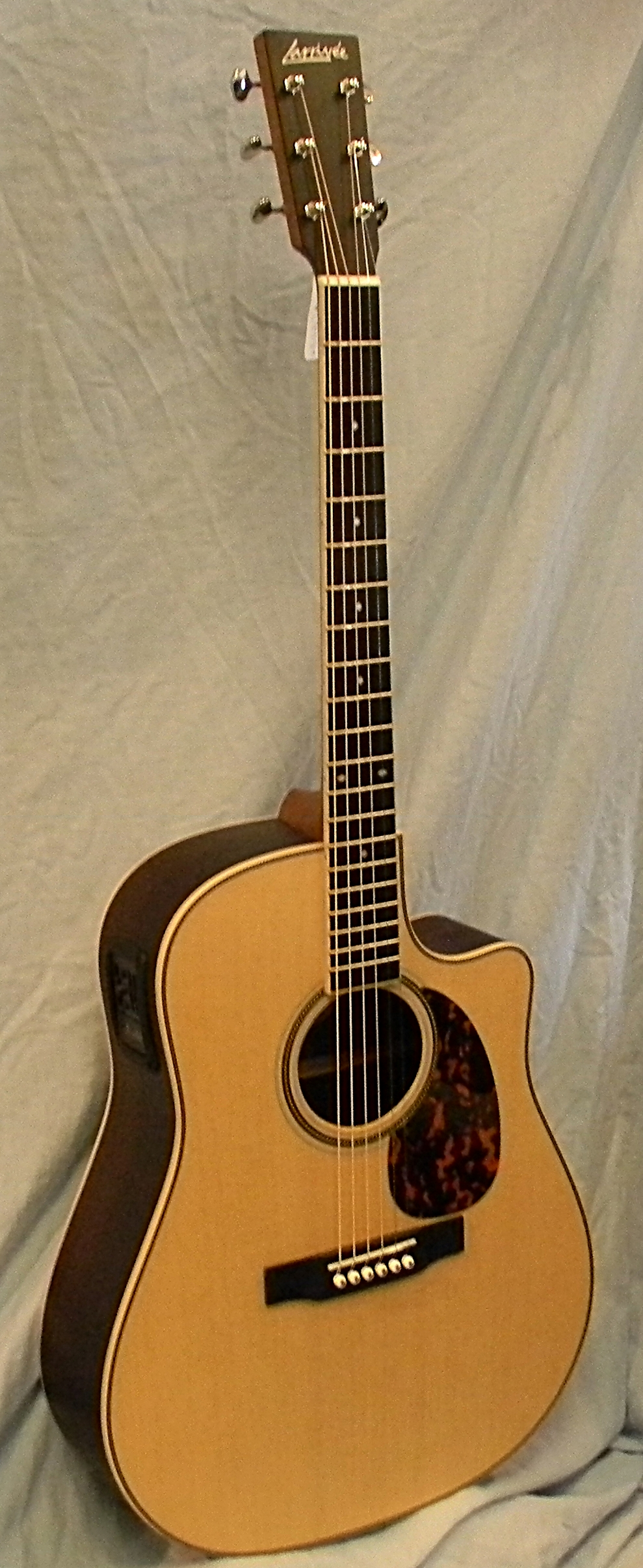 Larrivee DV 40RE is made in California of solid sitka spruce and Indian rosewood. List: $2,549.00 SALE: $1.949.00
