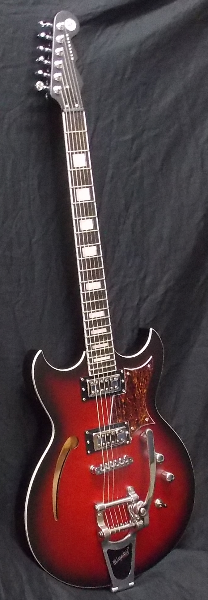 Tricky Gomez. The humor behind the name is lost on those not old enough to remember Trini Lopez or otherwise be aware of his Gibson signature model guitar. $1,099.00